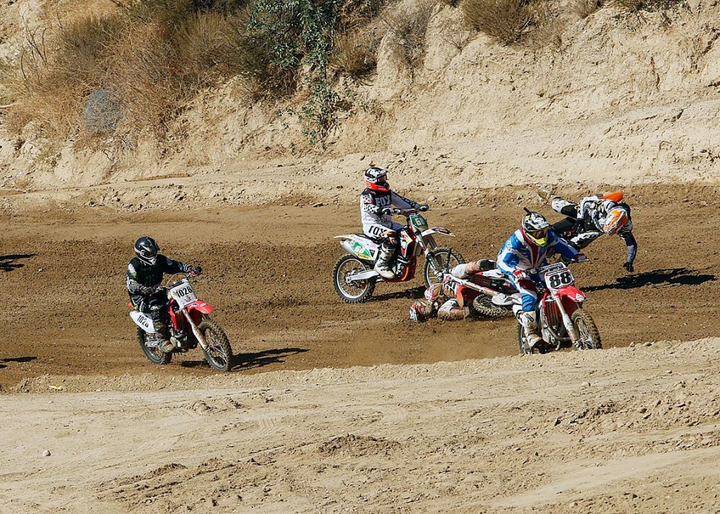 Tom White (orange) testing his new safety gear at Glen Helen 2015.